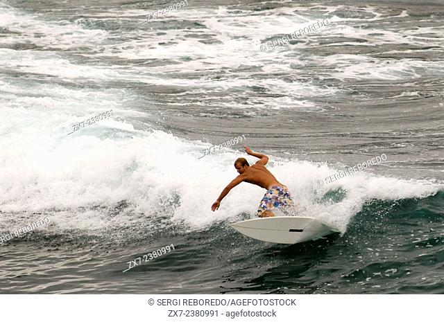Ho'okipa Beach. Maui. Hawaii. Surfer jumping into the water. Ho'okipa Beach Park, the original home of contemporary surfing on Maui