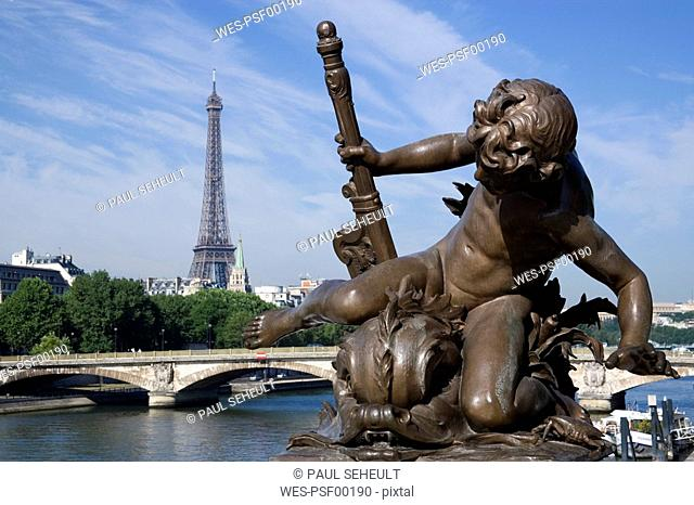 France, Paris, Pont Alexandre III, Bronze statue, Eiffel Tower in background