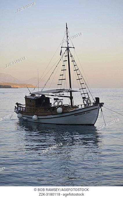 Wooden boat at sunrise on the sea