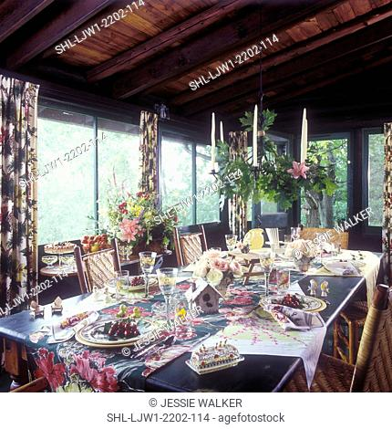 DINING ROOMS: Cottage look, vintage linens and tableware, enclosed porch, Hickory and cane twig chairs, summer set up on table, two bouquets of flowers
