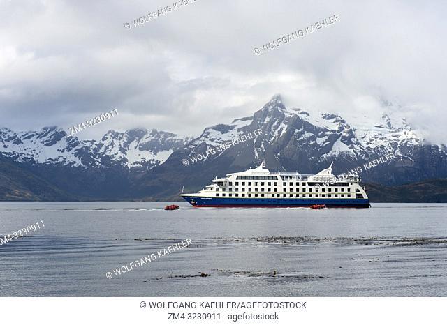 The cruise ship Ventus Australis near the Aguila Glacier in the Agostini Sound, Cordillera Darwin, in Tierra del Fuego in southern Chile
