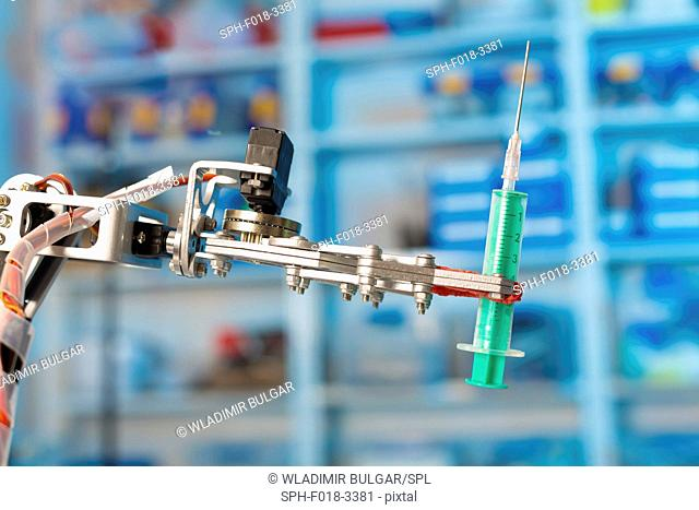 Robotic arm holding syringe in the laboratory
