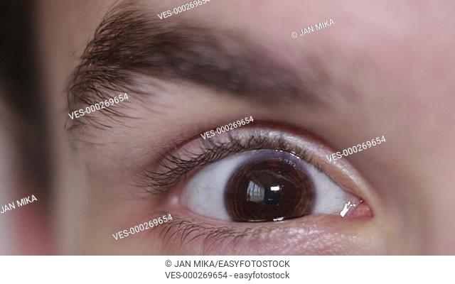 Macro of stressed eye of young man