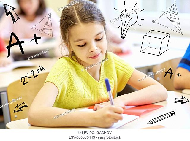 education, elementary school, learning and people concept - group of school kids with notebooks writing test in classroom over doodles