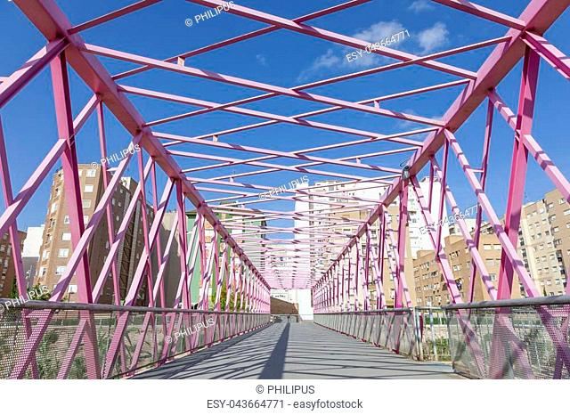 Pink pedestrian bridge in the city of Cartagena. Province of Murcia, southern Spain