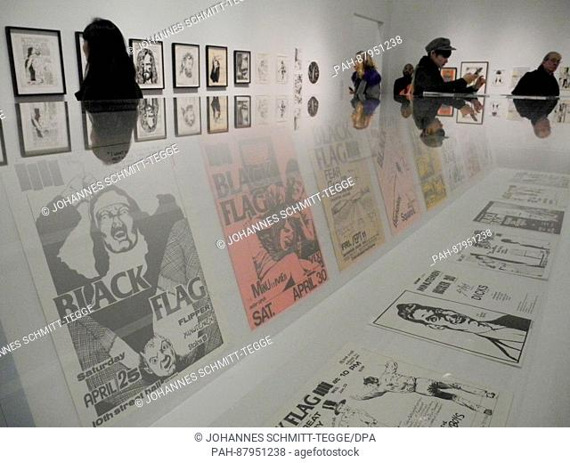 Visitors look at artworks of the exhibition 'A Pen Of All Work' by Raymond Pettibon at the New Museum in New York, USA, 07 February 2017