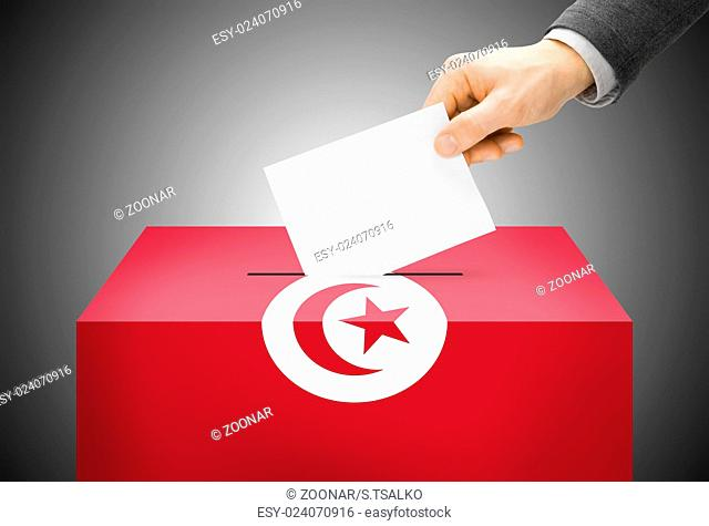 Voting concept - Ballot box painted into national flag colors - Tunisia