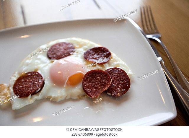 Close-Up shot of fried eggs with Turkish sucuk served on the plate, Taksim, Istanbul, Turkey, Europe