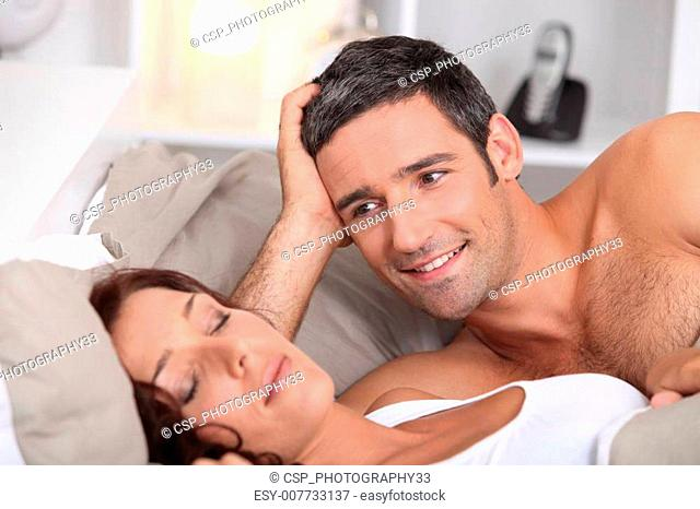 a man looking a wife sleeping deeply