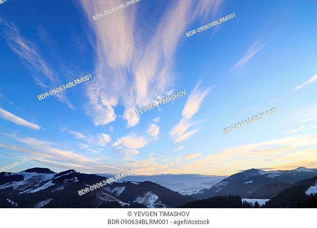red lit clouds over Dzembronya landscape in Ukraine Carpathian Mountains