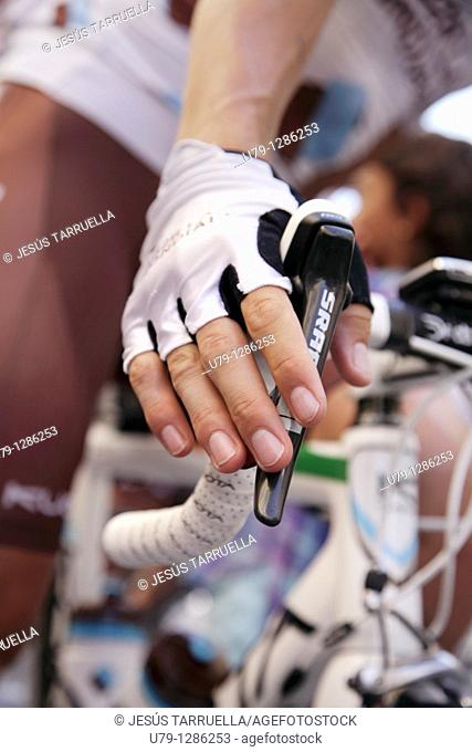 Details of the gloved hands of a rider in the control phase signatures. Tour of Spain. Villena. Alicante. Valencia. Spain. Europe. September 4, 2010