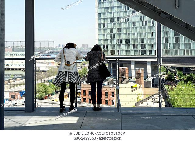 Two Young Women Looking Down from a terrace at the Whitney Museum, Meapacking District, New York City