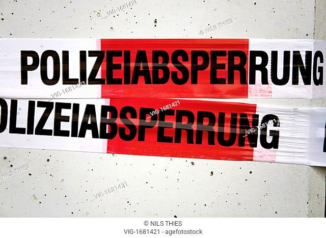 GERMANY, BREMERHAVEN, 25.07.2009, barrier tape with the writing German police cordon - Bremerhaven, Bremen, Germany, 25/07/2009