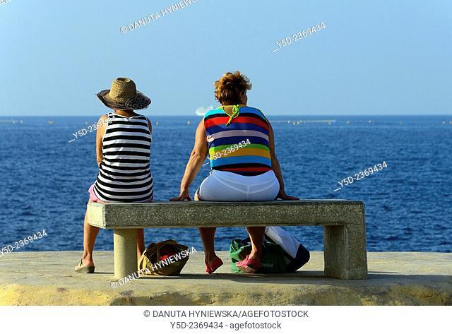 two mature women watching the sea, Malta