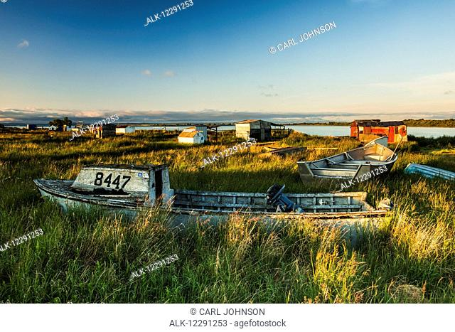 Old boats and shacks at the fish camp on the Newhalen River near the village of Newhalen in the Bristol Bay region of Alaska