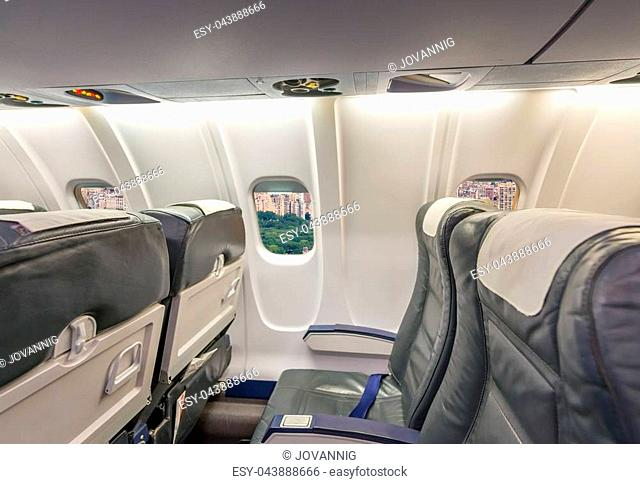 Airplane interior with view on Central park. Tourism concept