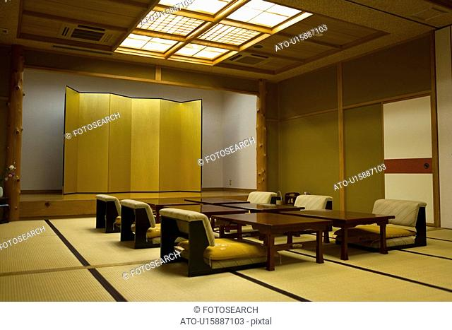 Japanese Style Banquet Room with a Stage and a Folding Screen