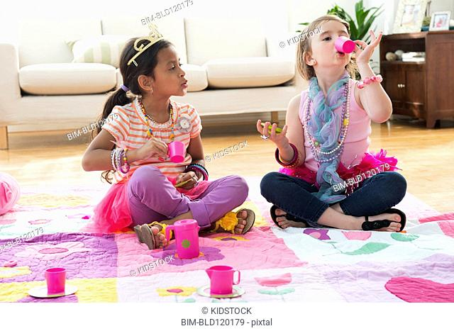 Girls having tea party