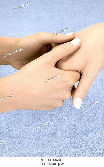Close up of woman receiving hand massage