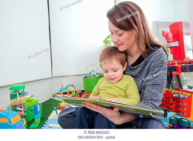 Mother reading to son at home