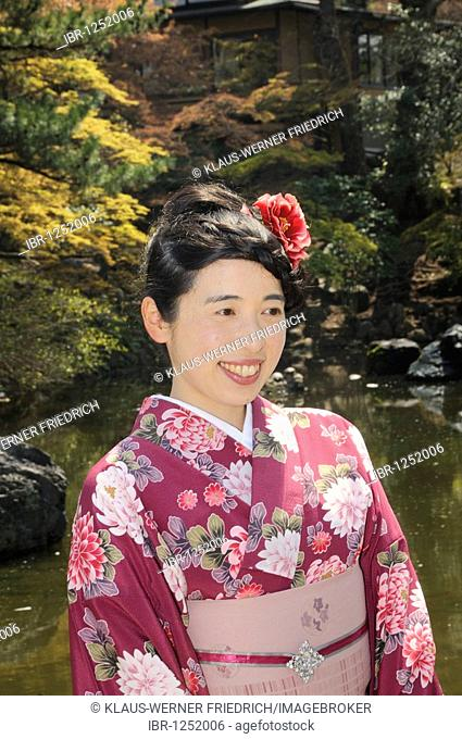 Japanese woman wearing a spring kimono at the Cherry Blossom Festival in Maruyama Park in Kyoto, Japan, East Asia, Asia