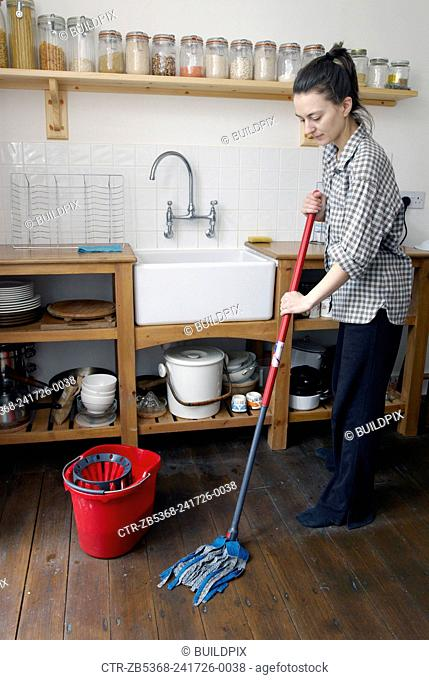 Woman mopping wooden floor