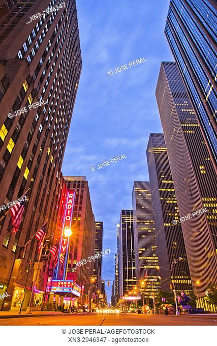At left Radio City, Music Hall, Rockefeller Center, 6th Avenue, Sixth Avenue, Avenue of the Americas, Midtown, Manhattan, New York City, New York, USA