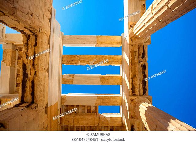 Looking up at a columns of Propylaea gateway in Acropolis of Athens, Greece