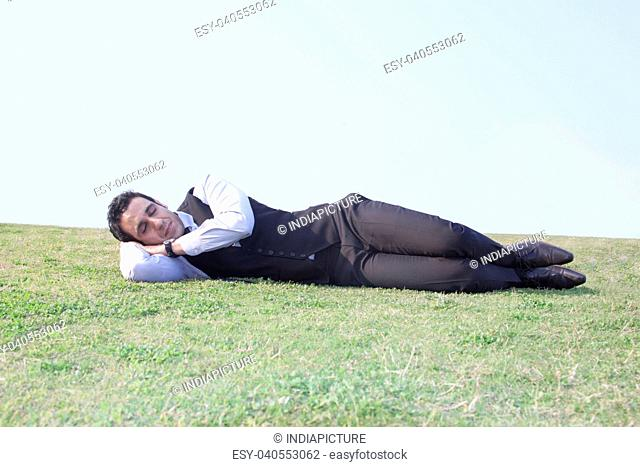Businessman sleeping , INDIA , DELHI