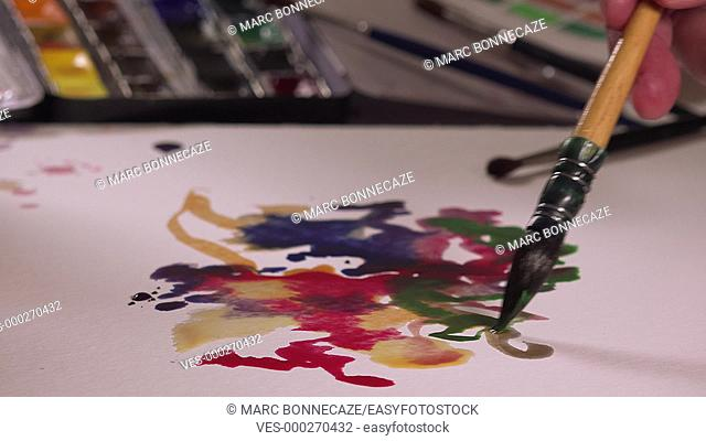 artist painting watercolor paints