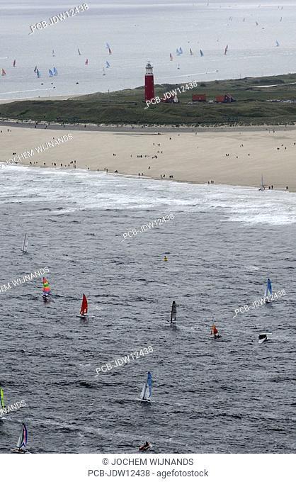 Texel, Ronde van Texel, Round Texel Race, the biggest regatta for Catamaran sailing boats Aerial view of the race, the boats are rounding the lighthouse of de...