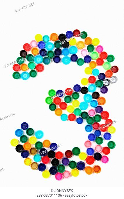 3 - number from the plastic caps isolated on the white background