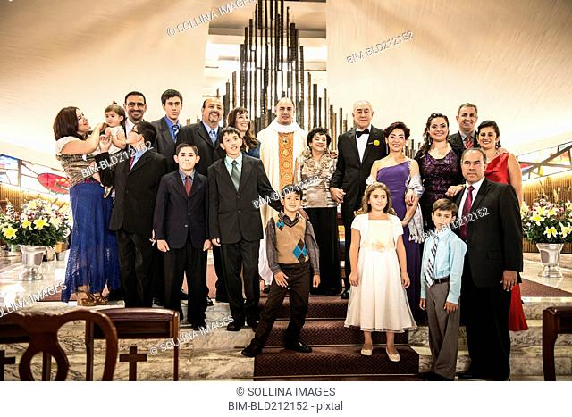 Family posing at wedding in church