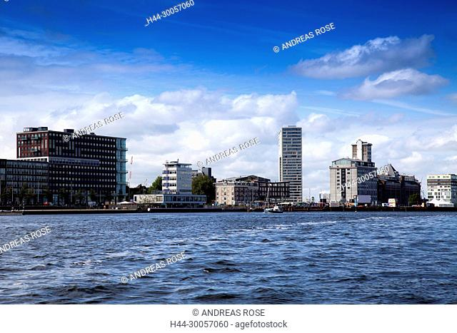 View over the Amstel on office building in the city center of Amsterdam, Holland, Netherlands