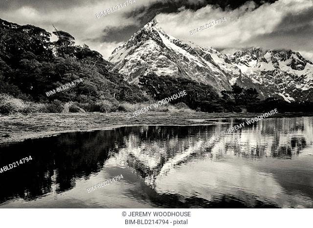 Mountains reflecting in remote lake, Key Summit, Southland, New Zealand