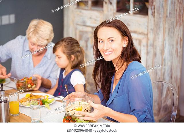 Happy woman having breakfast with family