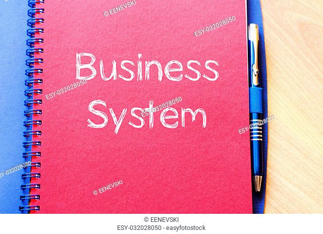 Business system text concept write on notebook with pen
