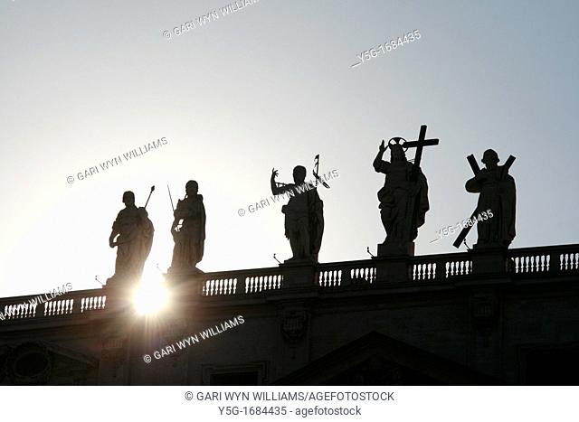 statues on top of colonnade at st peter's square in rome