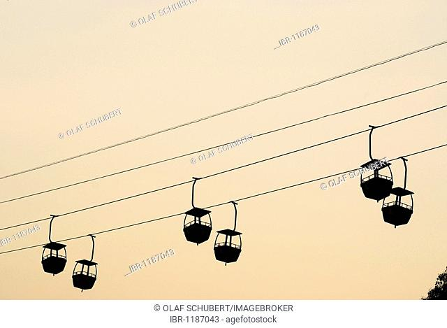 Cable car and gondolas in the evening light on the island Golang Yu, Xiamen, China, Asia