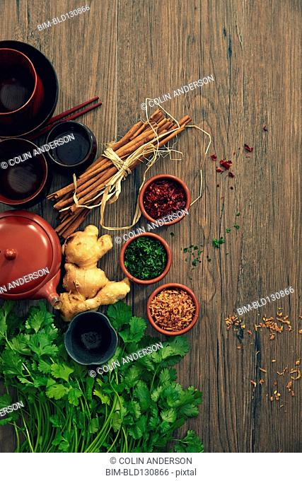 Spices, herbs and pots on wooden table