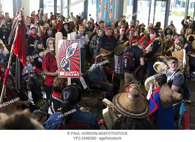 Seattle, Washington: Tribe members and supporters arrive at Seattle City Hall during the Indigenous Peoples' Day March and Celebration