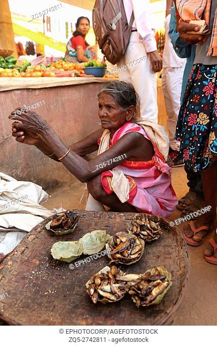 Woman selling dry fish, Tribal Market, Jagdalpur, Bastar District, Chattisgarh, India