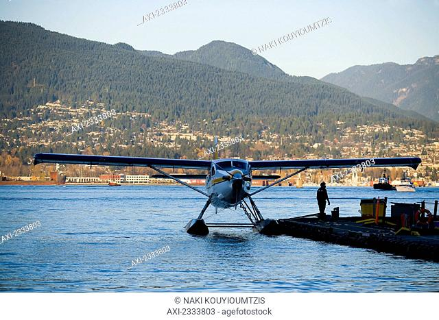 Seaplane moored to pier, Vancouver Waterfront, Harbor; Vancouver, British Columbia, Canada