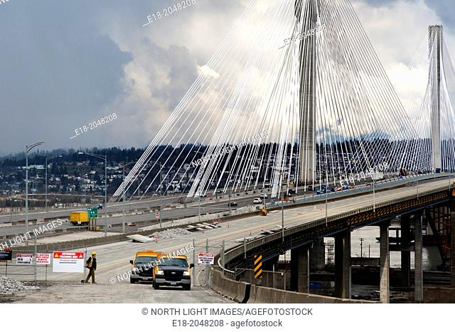Canada, BC, Vancouver. The newly completed 10 lane, cable-stayed Port Mann Bridge behind the old structure of the same name