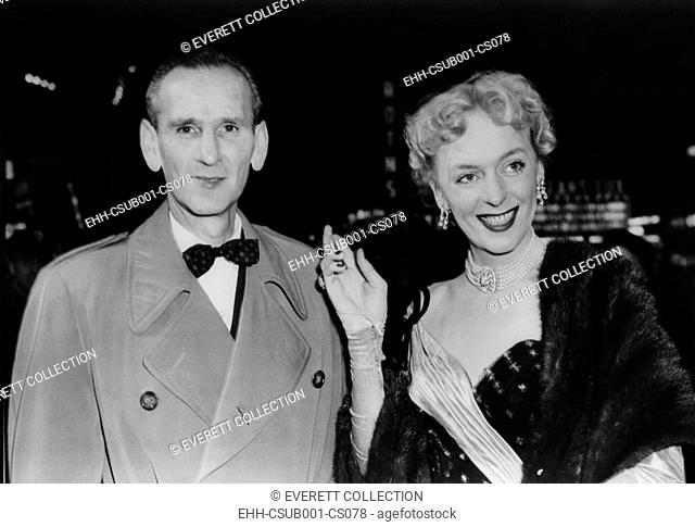 Christine Jorgensen arrives at theater with her escort, Charles Yates on Dec. 22, 1953. The pair were among many celebrities present for the first showing in...