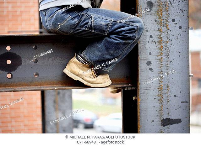 Construction iron worker sitting on I beam