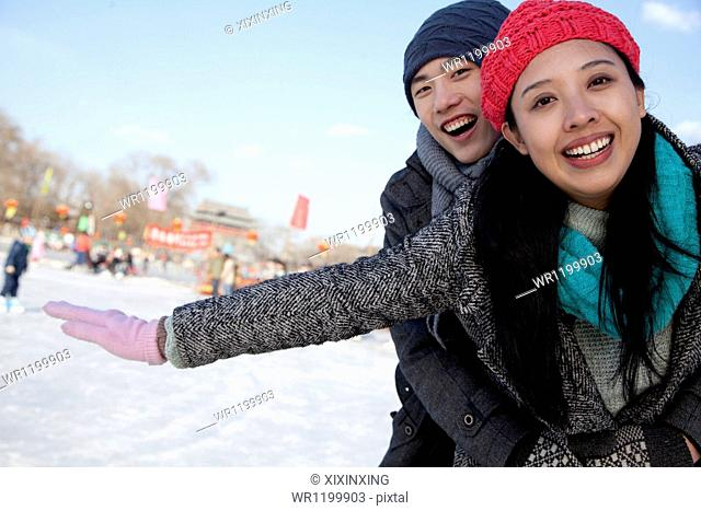 Young couple at ice rink