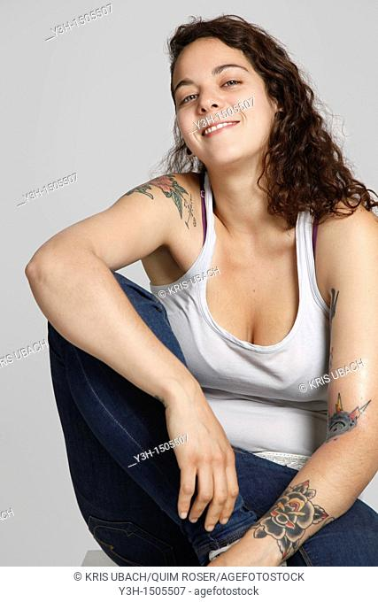 Studio shot of woman with tattoos