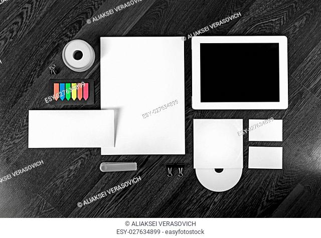 Corporate identity template on wooden table background. Photo of blank stationery set for placing your design. Top view