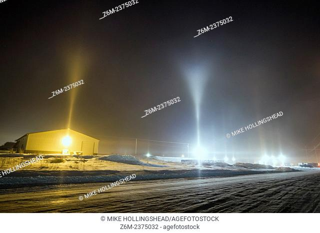 Y-shape light pillars form in Blair Nebraska in freezing temps and from conditions related to steam production from a corn milliing plant